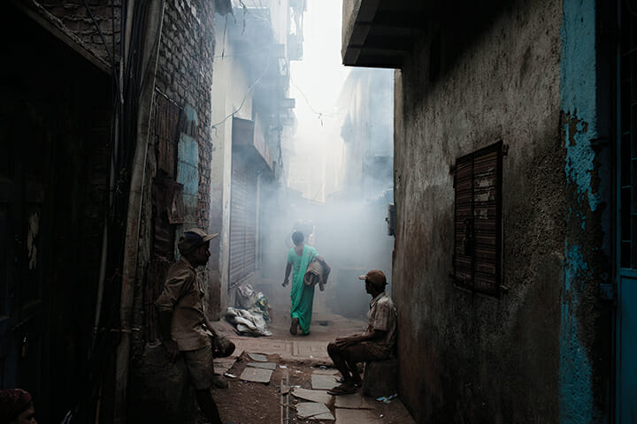 A woman walks through the Kumbharwada potting area of Dharavi in 2011.