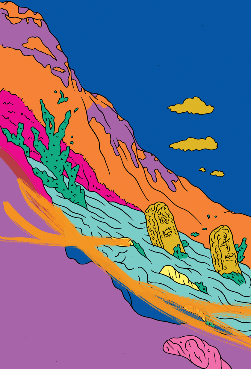 Stones are washed down the river on a brightly colored mountainside.