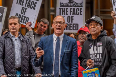 "Michael Kink speaking at the ""Greed"" rally outside Martin Shkreli's offices NYC Sept 2015 with ACT-UP & VOCAL-NY. / Erik McGregor"