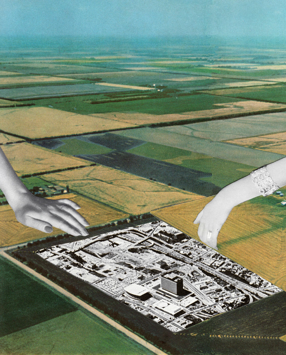 Two enormous hands plop a chunk of grey suburban sprawl on lush green farmland.