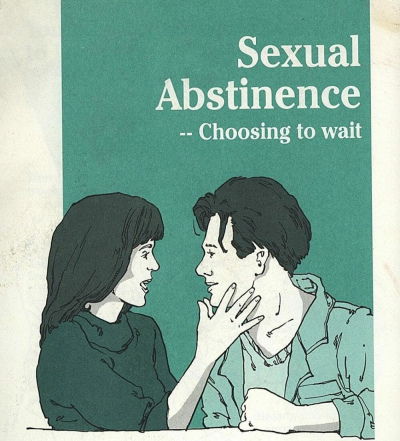 "A woman puts a hand over the face of a man below the words ""Sexual Abstinence - Choosing to wait"""