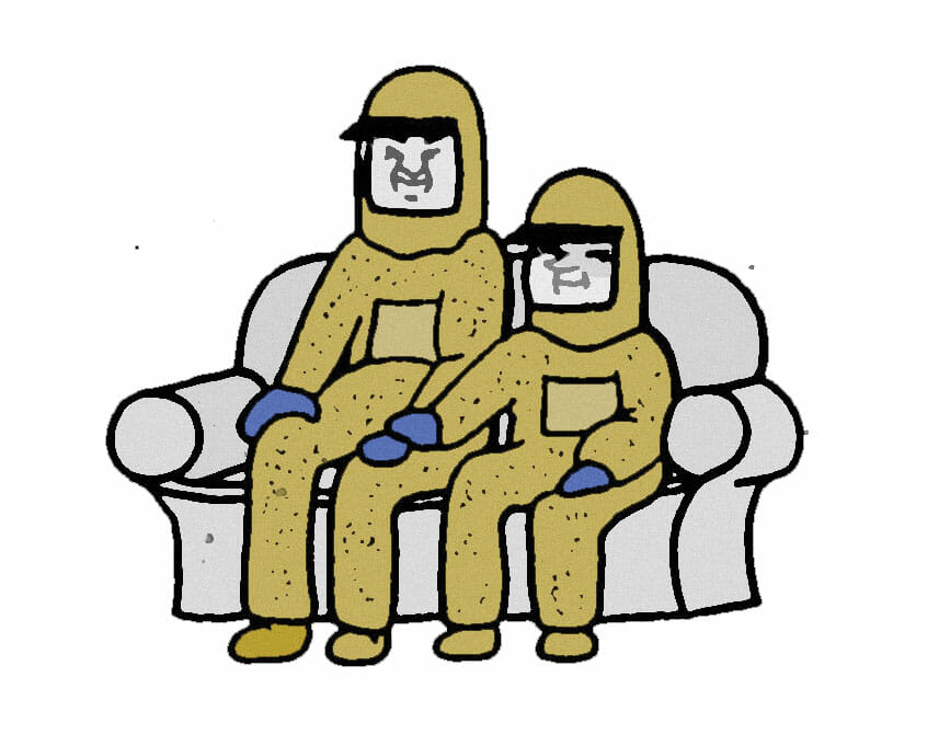 A couple wearing HAZMAT suits sits on the couch. The shorter of the pair has placed their hand on the other's rubber gloved hand.