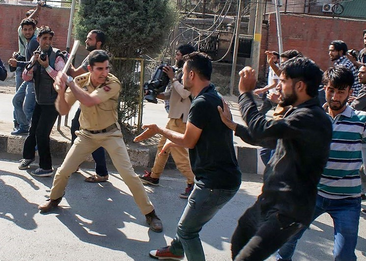 A photograph depicting an Indian policeman attacking innocents in Kashmir