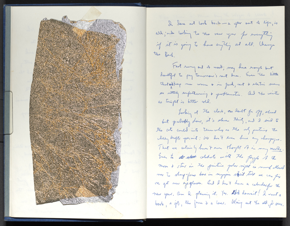 A journal entry with a piece of gold leaf paper taped to the opposite page.