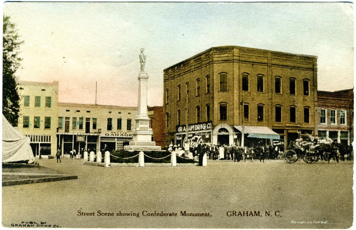 A Confederate statue on a pedestal is the focal point of Graham, North Carolina's town square in this postcard from the 1950s.